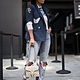Distressed, then dressed up with a tailored blazer and heels