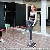 Upper body is next! With one foot on a slant board, grab some resistance bands by the handles, and use them to pull up onto your standing leg while reaching your other knee forward and back.
