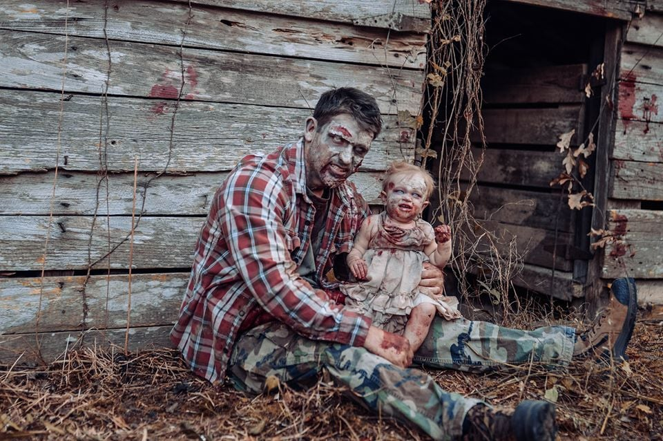 """What do you get when you cross zombies from the The Walking Dead with Michael Myers from Halloween? Photographer Tiffany Renfroe's superscary father-daughter photo shoot, which is certainly turning a few heads. Because Tiffany's husband is a huge horror fan, she had the idea to feature him in a zombie photo shoot, knowing he'd love it. The photographer then spent hours shooting and editing the photos, which include the couple's daughter, sharing them just in time for the shoot to go viral before Halloween. """"The inspiration behind the shoot was my husband Daniel and older daughter Kaiden's love for horror movies — specifically the classics — and The Walking Dead,"""" Tiffany told POPSUGAR. """"They're counting down until the next season of The Walking Dead is out!""""      Related:                                                                                                           Every Alien Fan Will Lose Their Sh*t Looking Through These Scary Maternity Photos               During a trip out to Oregon with her youngest daughter, Oakley, she staged a mom-and-daughter photo session. Once Tiffany returned, Daniel made a crack about how he hadn't had his own full-on photo shoot. """"I wanted to take pictures of just him and Oakley. But I like to be creative, different, and edgy,"""" she said. Because she's an extremely busy full-time labor and delivery nurse, Tiffany knew she had some thinking to do if she wanted to get a Halloween-themed shoot done before the holiday. """"Halloween month was in full swing. Daniel was being tagged in multiple Michael Myers posts, and even has a costume he uses to wake the kids up in the morning to be funny,"""" she said. """"He wears it to the gym, he makes music videos with it on, so it only made sense to include Michael Myers."""" """"I loved how good Daniel was at playing dead at the drop of a hat and seeing our three children helping and having fun. The list goes on."""" As for the supercreepy shed featured in the photos? The couple simply came across it while"""