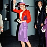 Princess Diana arrived in Hong Kong on tour in 1989 carrying off a purple and red colour clash with ease.