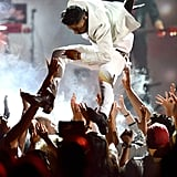 Miguel gave an enthusiastic performance at the May 19 Billboard Awards. Not quite enthusiastic enough to clear a fan's head when he jumped he stage, but still.