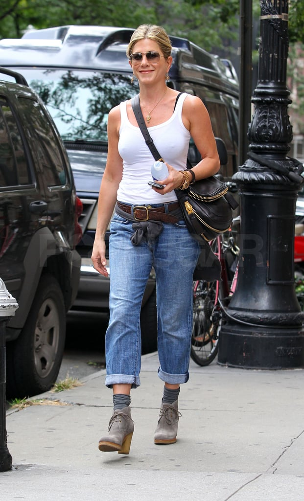 Jennifer Aniston left her NYC apartment today dressed for whatever weather came her way! Wearing a white tank, Jen looked equipped for Summer, but she was armed with a sweater for cooler Fall temps too. It's been a big week for Jen, who debuted her latest directing project, Five, on Monday and also cozied up to boyfriend Justin Theroux during an intimate portrait session with pal Terry Richardson. It's not the first time Jen and Justin posed for their friend, since Terry snapped one of the first public photos of Justin and Jen back in June. Hopefully, Justin will be on hand in LA on Oct. 17 when Jen's honored at the18th annual Elle Women in Hollywood Celebration for her achievements in film.