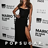 Alessandra Ambrosio donned a sexy strapless black corset gown with a thigh-grazing slit at the Mario Testino exhibit in Boston.
