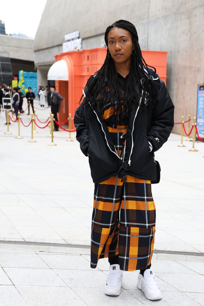 Style a plaid dress with a bomber jacket and white sneakers.
