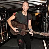 Chris Martin happily strummed away backstage.