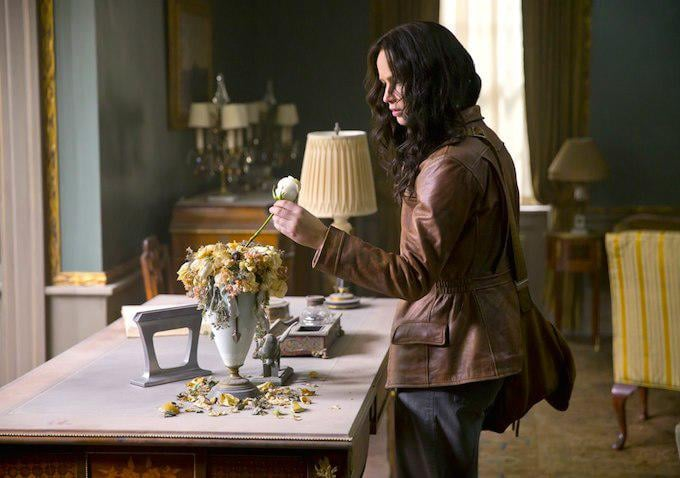 Katniss discovers the creepy white rose from the new trailer.