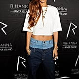 For the first launch afterparty, Rihanna wore her drop-crotch double-denim jeans with a cropped white tee.