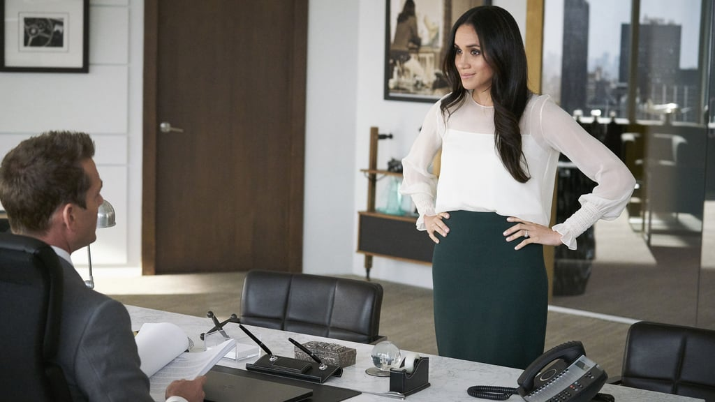 She also frequently pairs transparent blouses, like this simple white one with a sheer neckline, with those fitted pencil skirts.