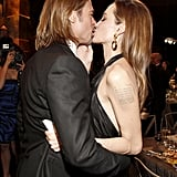 Brad and Angelina shared a kiss.