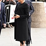 Meghan wore a black Givenchy coat.