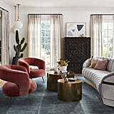 "The design team achieved this funky, elegant living room look by mixing velvet retro chairs with a timeless sofa. ""It was a balancing act,"" Zwickl told Better Homes & Gardens. ""The key was merging all the elements together and keeping scale in mind."""