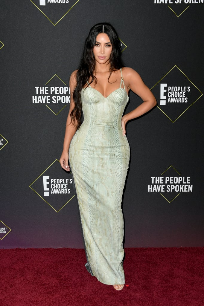 "Kim Kardashian was sizzling at the 2019 People's Choice Awards. On Sunday night, the 39-year-old mom of four decided to wear a gorgeous animal-print dress from Versace Archives in a mint green shade. While getting ready for the evening, Kim shared on Twitter, ""I'm excited for this dress I'm wearing; I've wanted to wear it for a long time."" And it's easy to see why: it's stunning! She also shared on her Instagram Story that underneath the ensemble, she rocked Skims High Waisted Bonded Shorts. It's a big night for the reality star. In addition to attending the show with mama Kris Jenner and sisters Kourtney and Khloé, Kim is nominated for multiple awards. She's nominated for social celebrity of the year and style star of the year, and Keeping Up With the Kardashians is nominated for reality show of the year. Check out photos of Kim at the People's Choice Awards with her family ahead.      Related:                                                                                                           The People's Choice Awards Red Carpet Was Like a Casting Call For the Hottest Dresses of the Year"