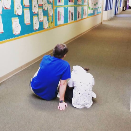 Teacher Comforting a Student on the Floor
