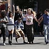 Kurt, Mercedes, Rachel, Mike, Brittany, Blaine, and Sam dance in the street.
