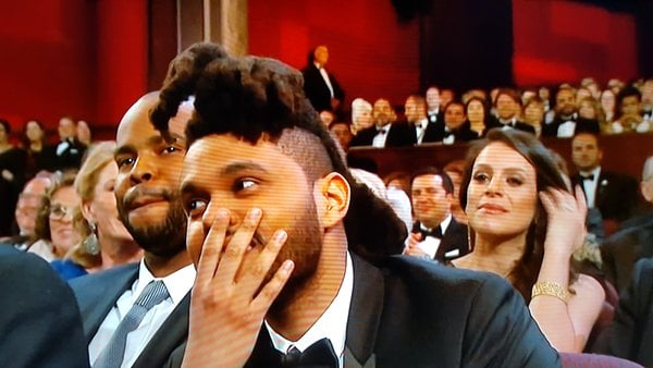 The Weeknd put a hand to his face as Stacey Dash walked off the stage.