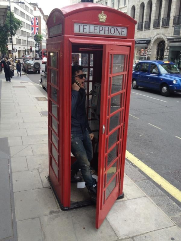Adam Lambert had fun in a phone booth while visiting London. Source: Twitter user adamlambert