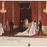 Princess Diana prepared for her wedding portraits in the Throne Room. Dress designers Elisabeth and David Emanuel helped arrange the train while photographer Patrick Lichfield held his camera.      Related:                                                                                                           The Details About Princess Diana's Untimely Death Are Still Shocking 20 Years Later
