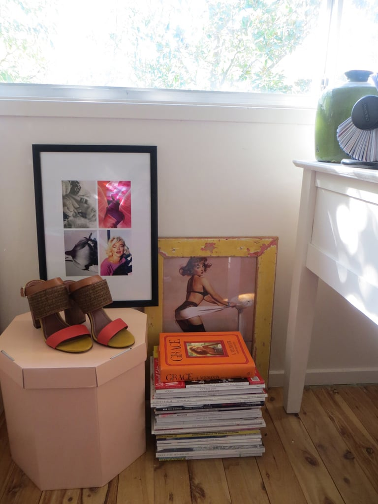 This is the girliest part of my room, all based around that hexagonal peach box I picked up at work. I love the look of it, but it has a purpose, too! It holds all my socks and tights, and the shoes on top are by Elizabeth and James.