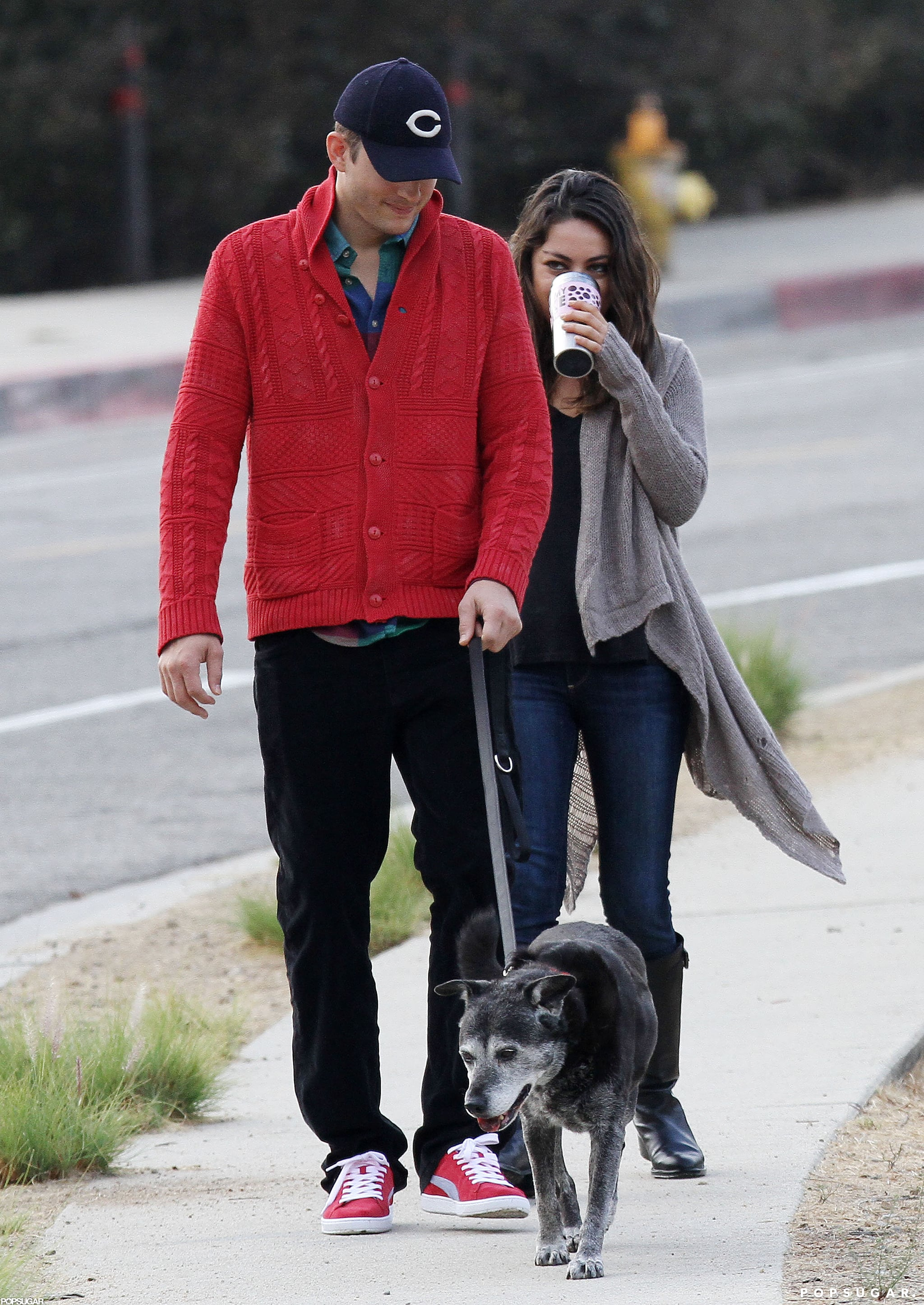 Ashton and Mila took their dog for an early-morning walk in LA in October 2012.