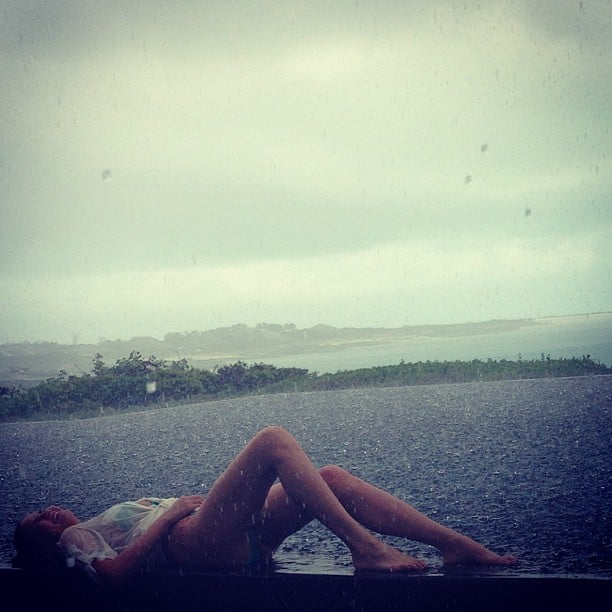 Chrissy Teigen wore a bathing suit and lounged in the rain. Source: Instagram user chrissy_teigen