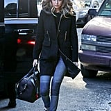Wearing Black Orchid Payton Moto jeans with a black coat and sneakers.