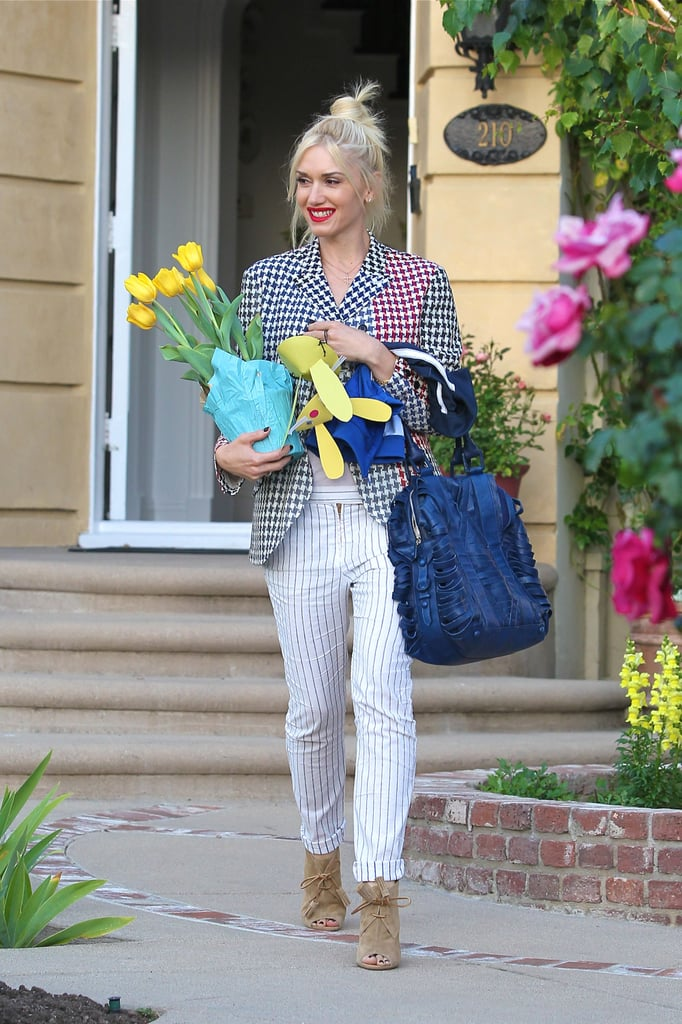Gwen Stefani was ready for Spring in white pinstriped pants as she stopped by her parent's house to celebrate Easter.