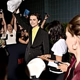 Watch Timothée Chalamet Hand Out Bagels at The King Premiere