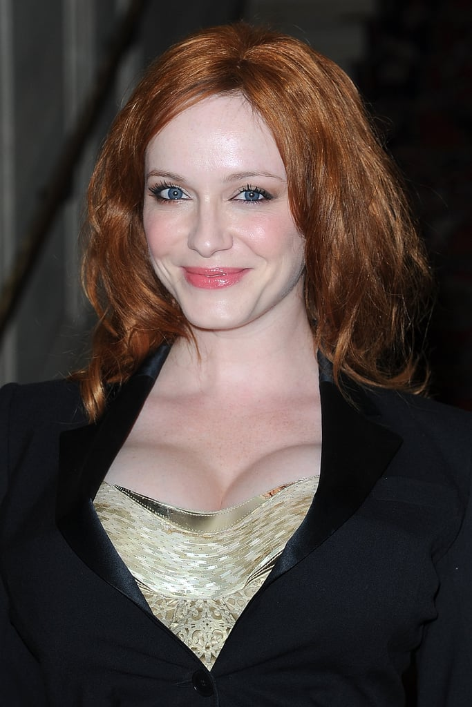 Christina Hendricks smiled at the Versace show for Paris Fashion Week.