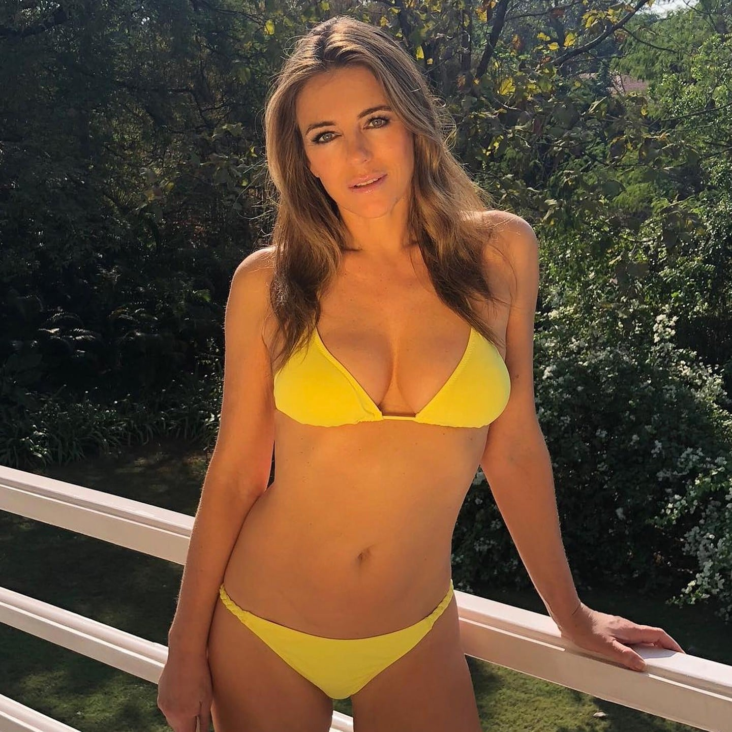 be6ceeda45 Elizabeth Hurley Wearing Yellow Bikini | POPSUGAR Fashion