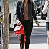 While strolling around LA, Sophia Bush punched up her business-casual look — black blazer, camel wrap blouse, and leather ankle boots — with her red Mulberry bag. This time, she opted to hold the handle.