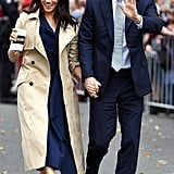 Meghan Markle Work Outfit Idea: A Navy Dress and Long Trench Coat