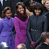 Michelle stood with her girls, all of them outfitted in equally sleek Winter coats.