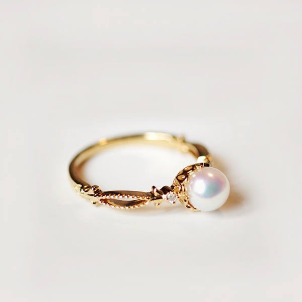A delicate pearl engagement ring ($619) made from solid 14k/18k gold.