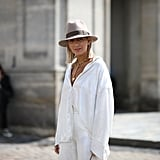 Tuck half of your white silk oversized shirt in to your pants and achieve that effortless look.