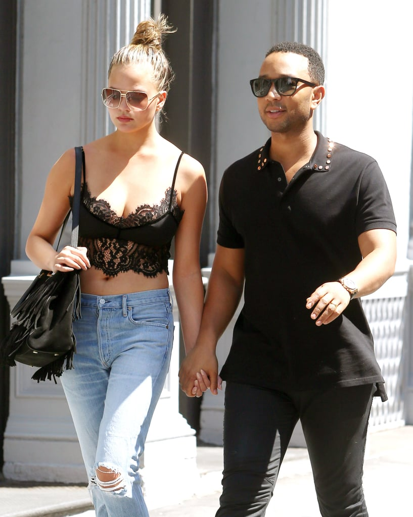 "Chrissy Teigen and John Legend were spotted holding hands while out and about in NYC on Saturday. Chrissy gave photographers a peek at her midriff in a black lace crop top and boyfriend jeans, while John kept things casual in an all black ensemble. Later that evening, the duo stepped out again to celebrate John's introduction as Belvedere's (Red) campaign ambassador at the Apollo Theater. Noticeably missing, though, was the couple's adorable daughter, Luna, who we often see on Instagram and Snapchat.       Related:                                                                Chrissy Teigen and John Legend Bring New Meaning to the Term ""Relationship Goals""                                                                   How John Legend Knew Chrissy Teigen Was the One                                                                   Chrissy Teigen Is the Queen of Sexy Snaps"