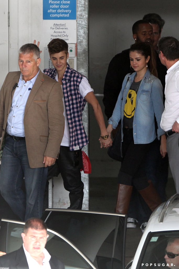 Justin Bieber and Selena Gomez held hands as they stepped out in New Zealand today. They're in Auckland after visiting Australia earlier this week for Justin's Believe promotional tour. He taped an episode of Australia's Got Talent in Melbourne and then headed to Sydney, where he performed a special acoustic concert and appeared on the morning show, Sunrise. Justin followed up the string of fun stops with a charitable visit to a Children's Hospital this afternoon. It's been a busy few weeks of travels for Justin, who already toured Asia earlier this month. He's had Selena by his side, though, despite recent breakup rumors, and the couple have even more excitement in store since Selena's 20th birthday is on Sunday.