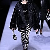 For Her Second Look, She Wore Zebra Trousers, a Black Puffer Coat, and Oversize Hoop Earrings
