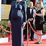 Busy Philipps glowed in a navy Gabriela Cardena gown, Brian Atwood pumps, and a stunning gemstone statement necklace.
