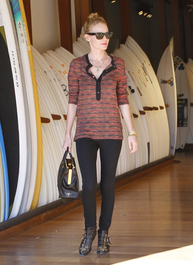 Kate Bosworth accessorized her laid-back look with a black Prada tote and matching Chloé booties while perusing the Burton shop in LA.