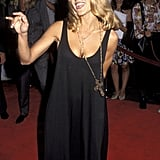 Telling it like it is in a minimal black tank dress and gothic cross necklace in '92.