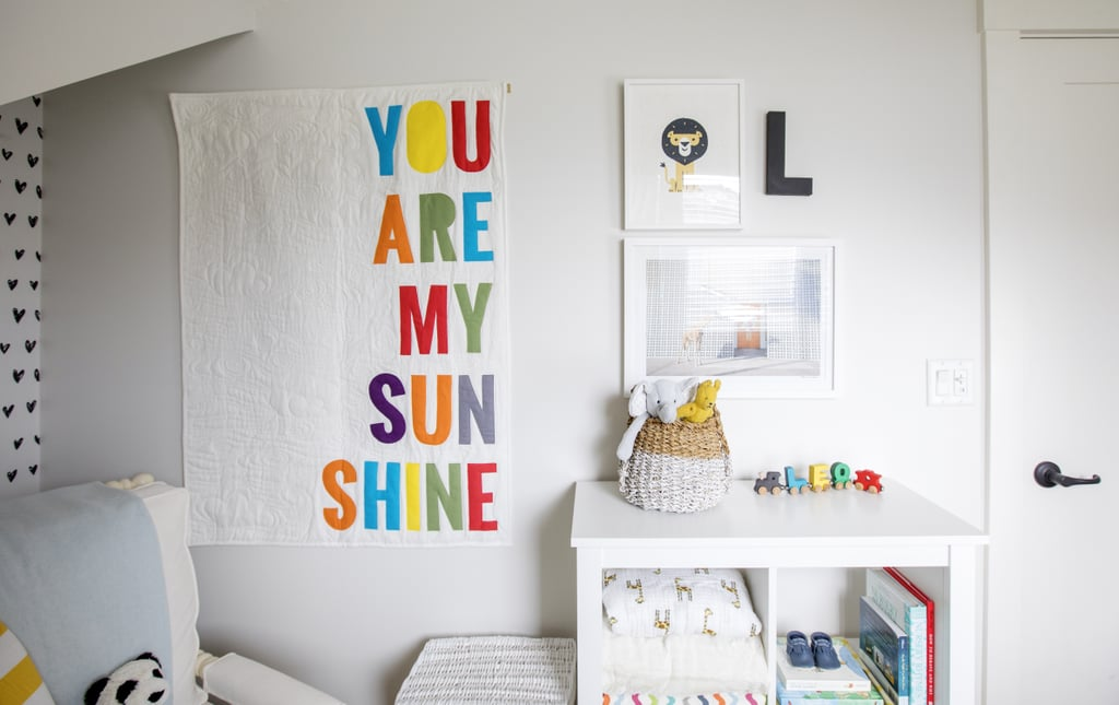 Thoughtful art, cozy accents, and pops of vibrant color set the tone in Leo's darling nursery.