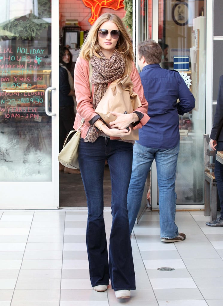 Rosie Huntington-Whiteley perfected the off-duty vibe in a pair of curve-hugging flares and a nonchalant scarf.
