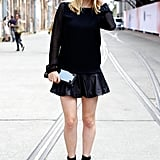 A flirty hemline gave this slick all-black ensemble a pop of girliness.