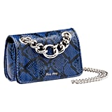 For me, there's just something about Miu Miu bags. And when the label recently announced their new Club Collection, I fell hard for this royal blue python design ($2,680). It's edgy, perfect for print mixing, and more unique than any chainstrap satchel I've ever seen.  — SW