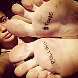 "Miley Cyrus showed off her new ""Rolling $tone"" foot tattoos. Source: Instagram user mileycyrus"