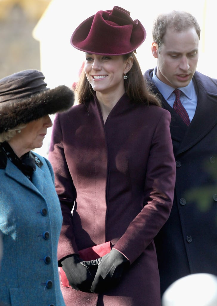 Kate Middleton opted for a burgundy coat and fascinator for her first Christmas as part of the royal family today. Duchess Catherine greeted some young fans and stood close by her husband Prince William as they arrived at  St. Mary Magdalene Church in Norfolk, England. Kate and William were also joined by his brother Prince Harry, their father Prince Charles, and his wife Camilla. Unfortunately this holiday season may be a difficult one for the royal family, since Prince Philip is in the hospital. Harry and William reportedly visited Philip on Friday, and apparently he is set to be back at home soon. The Duke and Duchess of Cambridge have already had quite a festive Christmas, attending the annual preholiday royal family meal. Prince William also showed off his dance moves when he and Kate visited his mother Diana's favorite charity last week. Overall it has been quite a 2011 for the newlyweds, and we're celebrating by taking a look back at Kate and William's cutest moments from the royal wedding to their North American tour and beyond.