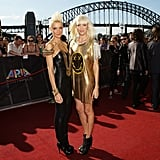 Miriam and Oliva Nervo coordinate in gold and black.