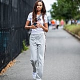 Joan Smalls Wore a White Printed Tee and Grey Sweats as She Left the Brandon Maxwell Show