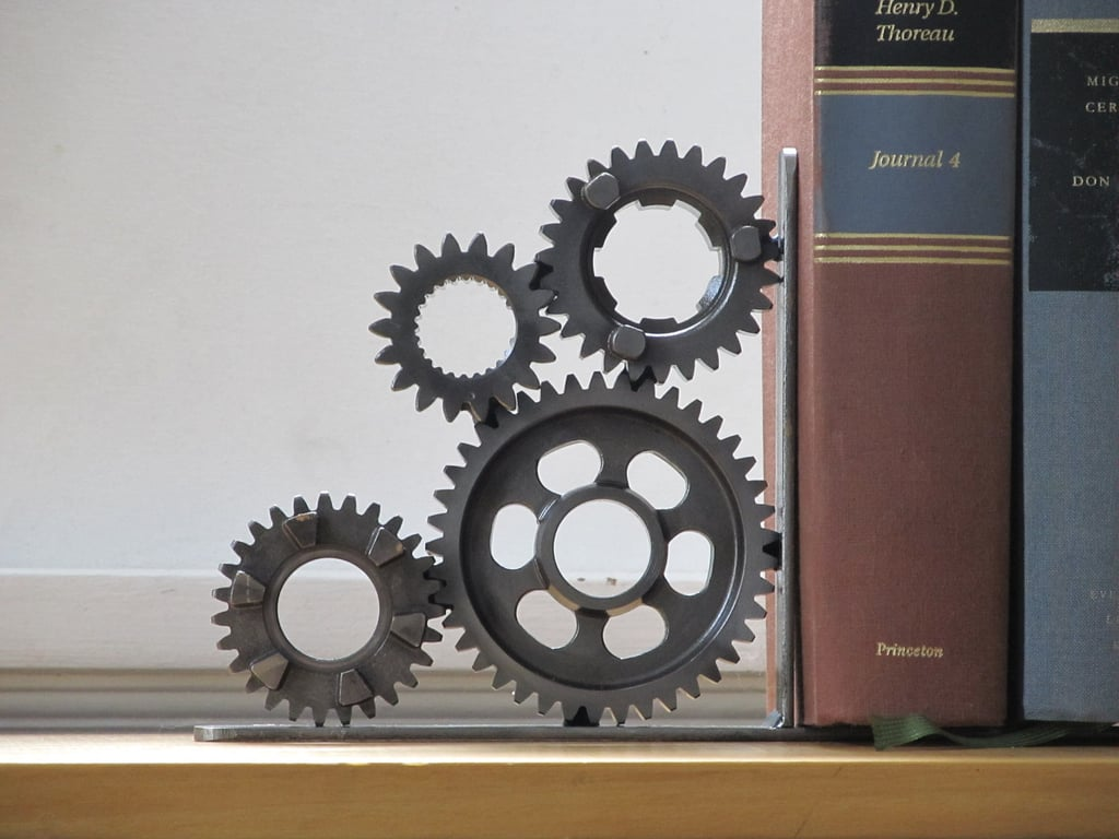 Crafted of motorcycle transmission gears, this four gear bookend ($85) comes by itself rather than in a set, an option for the eternal tinkerer who wants a bookshelf with a statement.