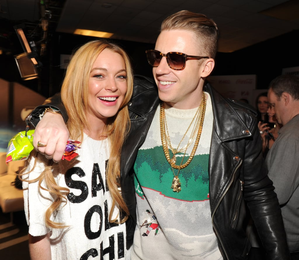 Lindsay Lohan posed for photos with Macklemore backstage.